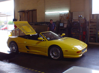 Yellow Sports Car Being Repaired